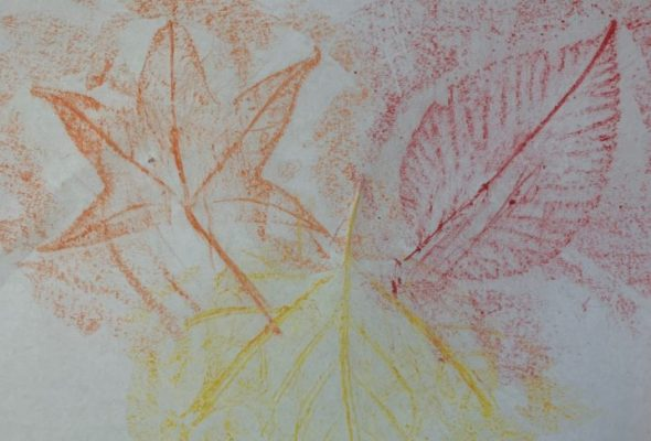 orange, yellow, and red leaves traced on paper