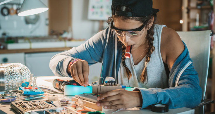 teen girl working on STEM project