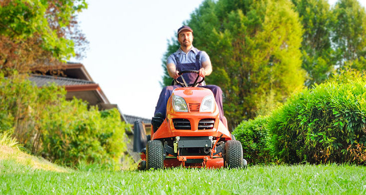 father on a lawnmower