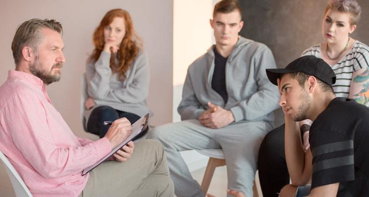 School aid talking to group of teenager