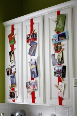 cards hanging on red ribbon on a door