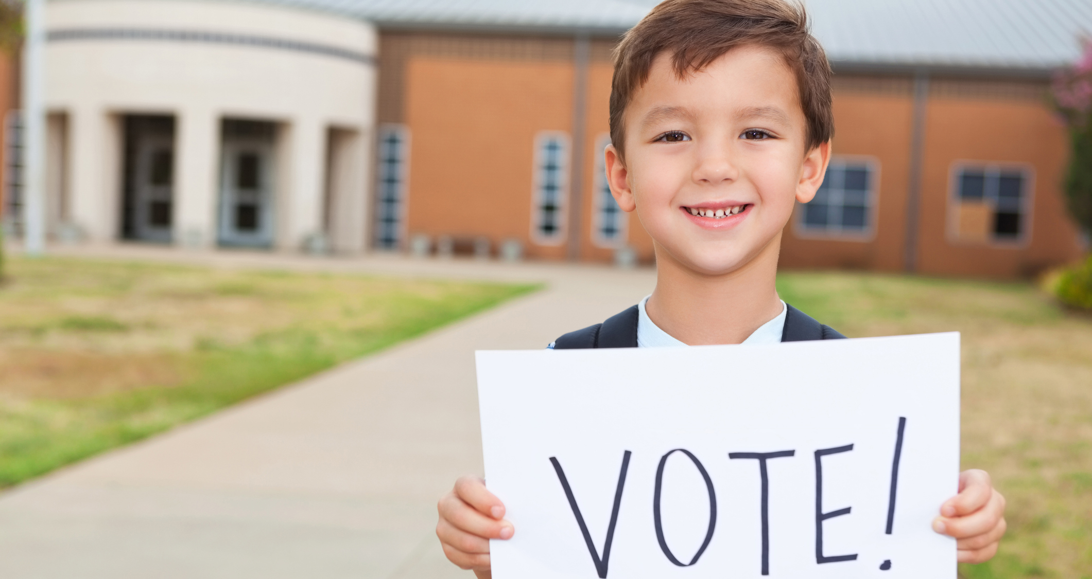 Child with vote sign
