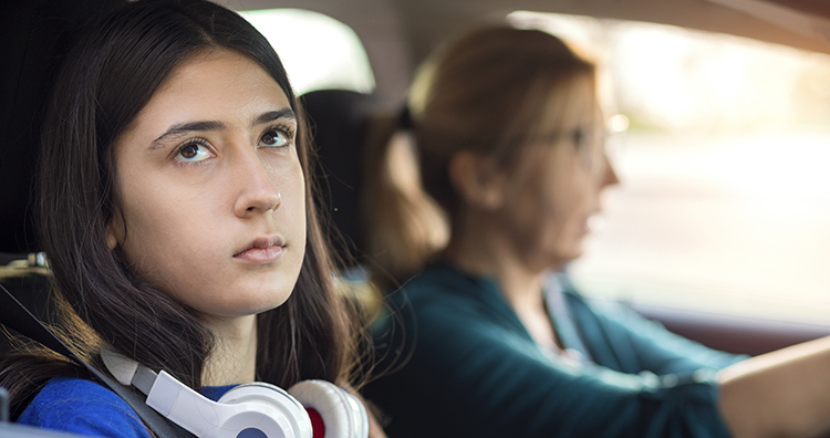 mom parenting her teen in car