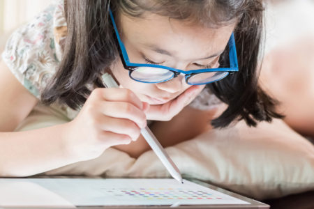 little girl using math app