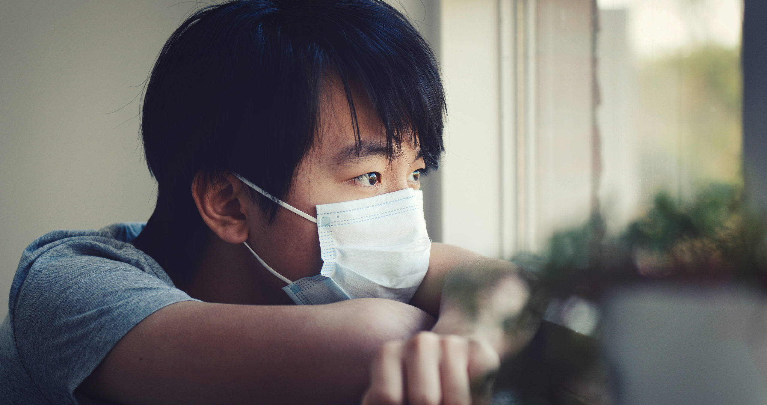Teen wearing mask looking sad